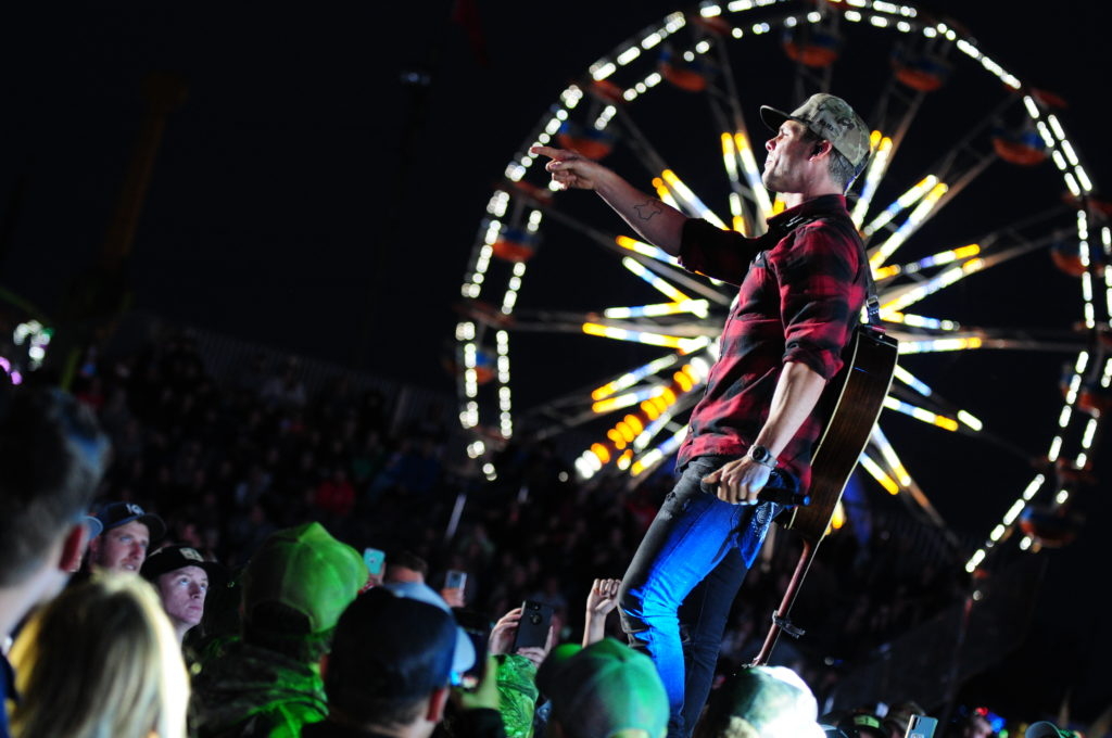Granger Smith Performance with Ferris Wheel in Background