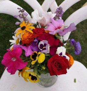 A vase with many colourful flowers