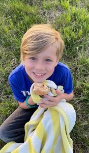 Young boy with lizard